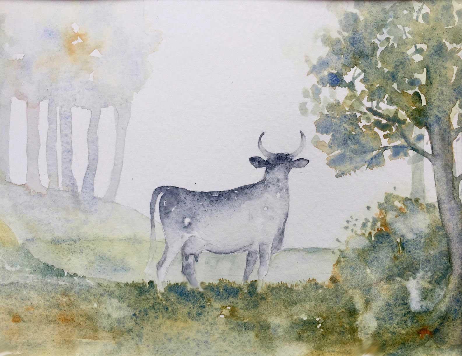 Kuh auf Waldlichtung